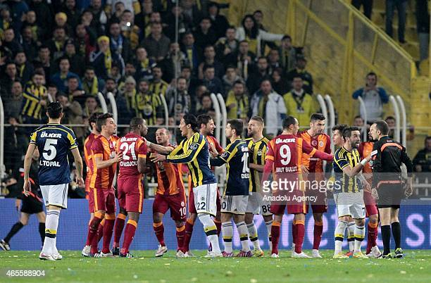 Opponent players argue with each other during the Turkish Spor Toto Super League derby game between Fenerbahce and Galatasaray at Sukru Saracoglu...