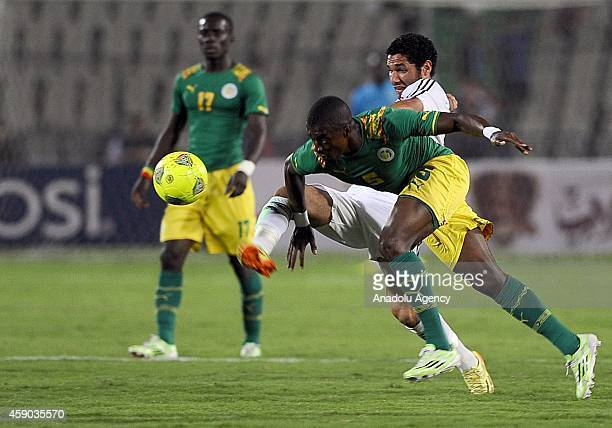 Opponent players in action during the Africa Cup of Nations qualification group G match between Egypt and Senegal at International Cairo Stadium in...