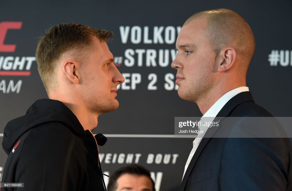 Opponents Alexander Volkov of Russia and Stefan Struve of The Netherlands face off during the UFC Ultimate Media Day at the Inntel Rotterdam Centre Hotel on August 31, 2017 in Rotterdam, Netherlands.