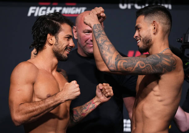 Opponents Alexandre Pantoja of Brazil and Brandon Royval face off during the UFC Fight Night weigh-in at UFC APEX on August 20, 2021 in Las Vegas,...