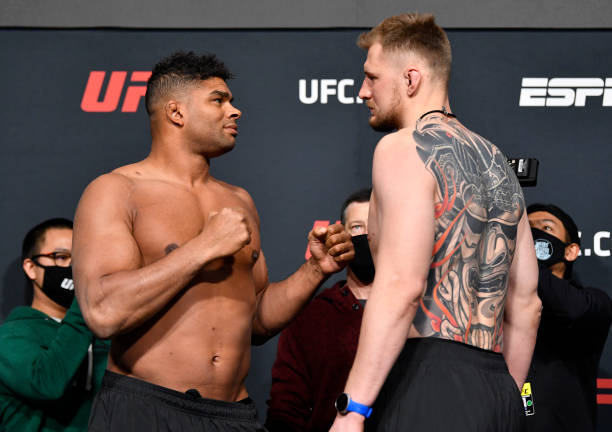 Opponents Alistair Overeem of the Netherlands and Alexander Volkov of Russia face off during the UFC weigh-in at UFC APEX on February 05, 2021 in Las...