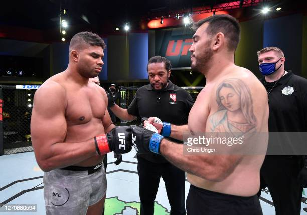 Opponents Alistair Overeem of the Netherlands and Augusto Sakai of Brazil face off prior to their heavyweight fight during the UFC Fight Night event...