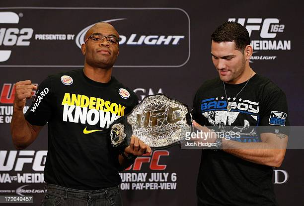 Opponents Anderson Silva and Chris Weidman pose for photos during the final UFC 162 press conference at the MGM Grand Hotel/Casino on July 4 2013 in...