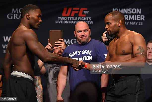 Opponents Anthony 'Rumble' Johnson and Daniel Cormier shake hands during the UFC 187 weighin at the MGM Grand Conference Center on May 22 2015 in Las...