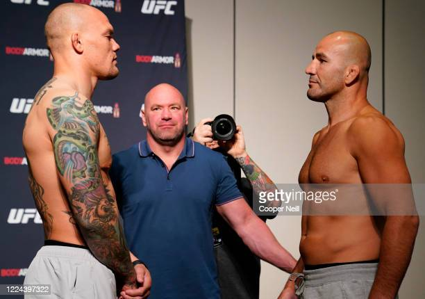 Opponents Anthony Smith and Glover Teixeira of Brazil face off during the official UFC Fight Night weighin on May 12 2020 in Jacksonville Florida