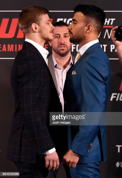Opponents Arnold Allen of England and Makwan Amirkhani of Finland face off during the UFC Ultimate Media Day at Glaziers Hall on March 16 2017 in...