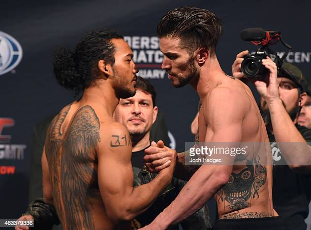 Opponents Benson Henderson and Brandon Thatch shake hands during the UFC weigh-in at the 1stBank Center on February 13, 2015 in Broomfield, Colorado.