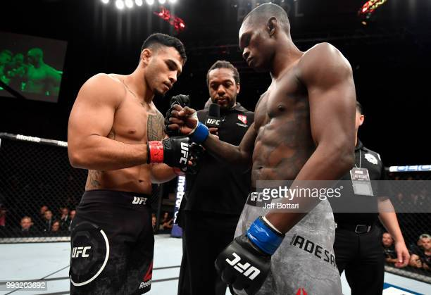 Opponents Brad Tavares and Israel Adesanya of Nigeria face off prior to their middleweight bout during The Ultimate Fighter Finale event inside The...