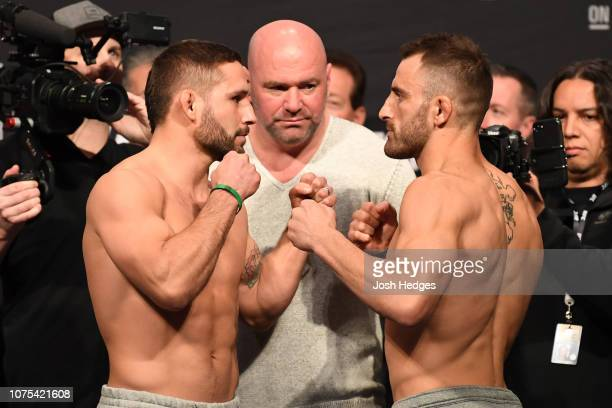 Opponents Chad Mendes and Alexander Volkanovski of Australia face off during the UFC 232 weighin inside The Forum on December 28 2018 in Inglewood...