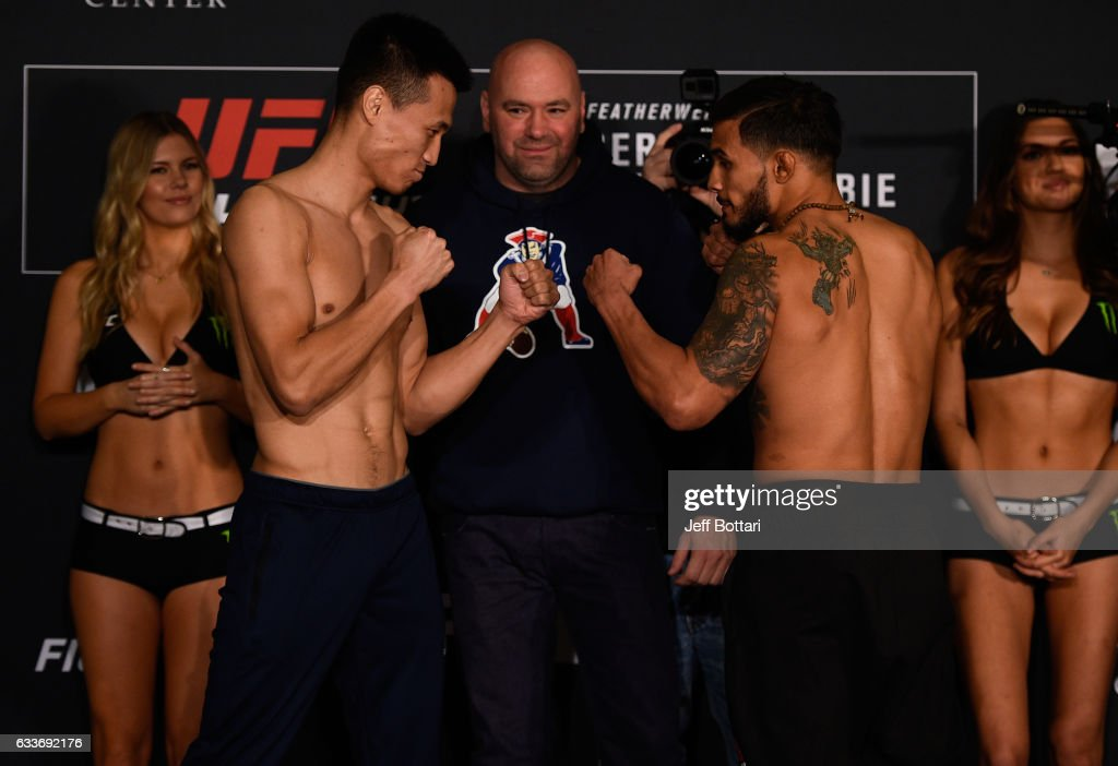 Opponents Chan Sung Jung of South Korea and Dennis Bermudez face off during the UFC Fight Night weigh-in at the Sheraton North Houston at George Bush Intercontinental on February 3, 2017 in Houston, Texas.
