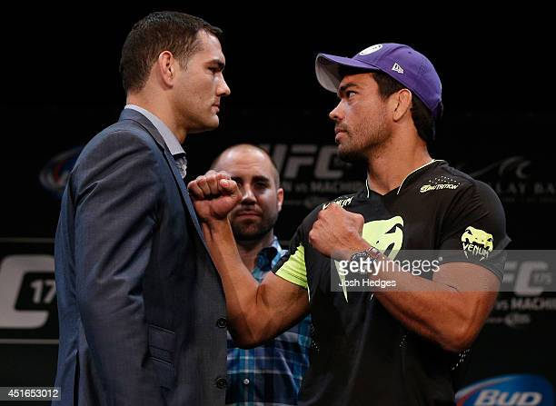 Opponents Chris Weidman and Lyoto Machida face off during the UFC Ultimate Media Day at the Mandalay Bay Resort and Casino on July 3 2014 in Las...