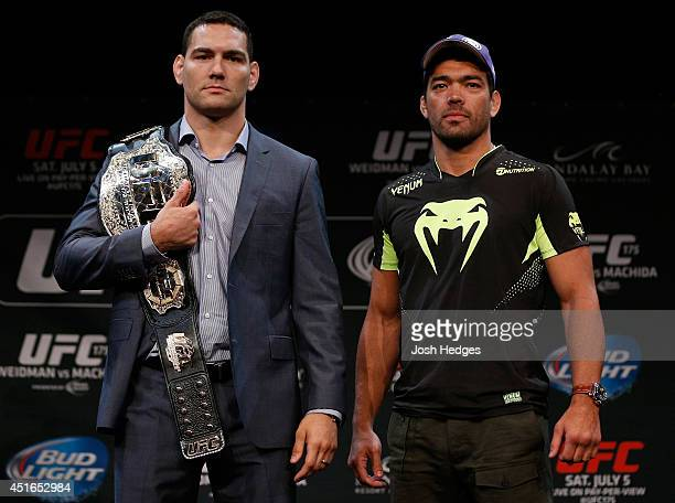 Opponents Chris Weidman and Lyoto Machida pose for photos during the UFC Ultimate Media Day at the Mandalay Bay Resort and Casino on July 3, 2014 in...