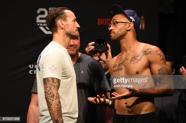 Opponents CM Punk and Mike Jackson face off during the UFC 225 weighin at the United Center on June 8 2018 in Chicago Illinois