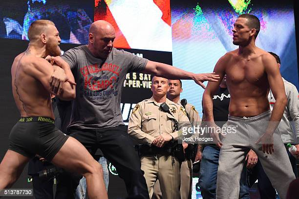 Opponents Conor McGregor of Ireland and Nate Diaz face off during the UFC 196 Weigh-in at the MGM Grand Garden Arena on March 4, 2016 in Las Vegas,...
