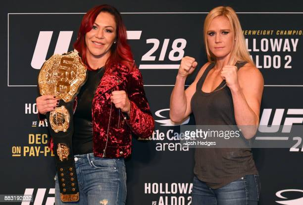 Opponents Cris Cyborg of Brazil and Holly Holm pose for photos ahead of their UFC 219 fight during the UFC 218 Ultimate Media Day at the DoubleTree...