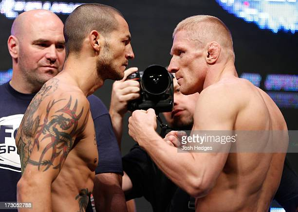 Opponents Cub Swanson and Dennis Siver face off during the UFC 162 weigh-in at the Mandalay Bay Events Center on July 5, 2013 in Las Vegas, Nevada.