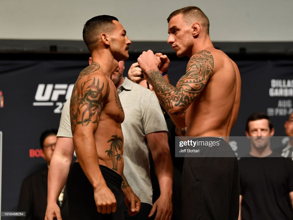 Opponents Cub Swanson and Renato Moicano of Brazil face off during the UFC 227 weigh-in inside the Orpheum Theater on August 3, 2018 in Los Angeles, California.