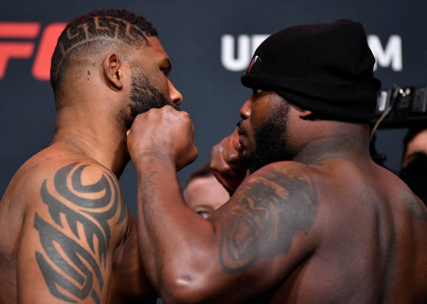 Opponents Curtis Blaydes and Derrick Lewis face off during the UFC weigh-in at UFC APEX on February 19, 2021 in Las Vegas, Nevada.