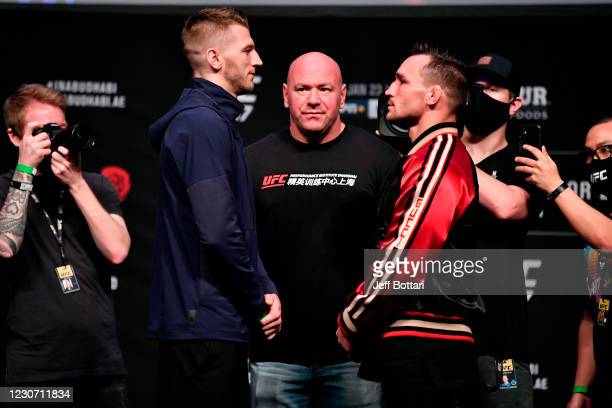 Opponents Dan Hooker of New Zealand and Michael Chandler face off during the UFC 257 press conference event inside Etihad Arena on UFC Fight Island...