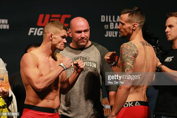 Opponents Daron Cruickshank and James Krause face off during the UFC weighin at the United Center on July 24 2015 in Chicago Illinois
