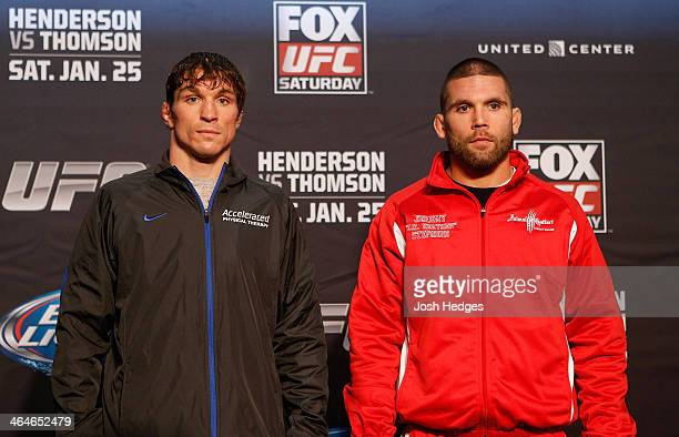 Opponents Darren Elkins and Jeremy Stephens pose for photos during the FOX UFC Saturday Ultimate Media Day at the United Center on January 23 2014 in...