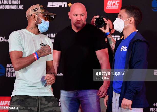 Opponents Deiveson Figueiredo of Brazil and Joseph Benavidez face off during the UFC Fight Night weighin inside Flash Forum on UFC Fight Island on...
