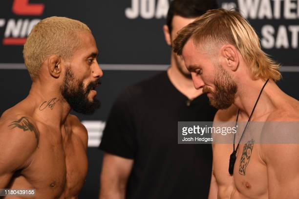 Opponents Deiveson Figueiredo of Brazil and Tim Elliott face off during the UFC Fight Night weighin at the Westin Tampa Waterside on October 11 2019...