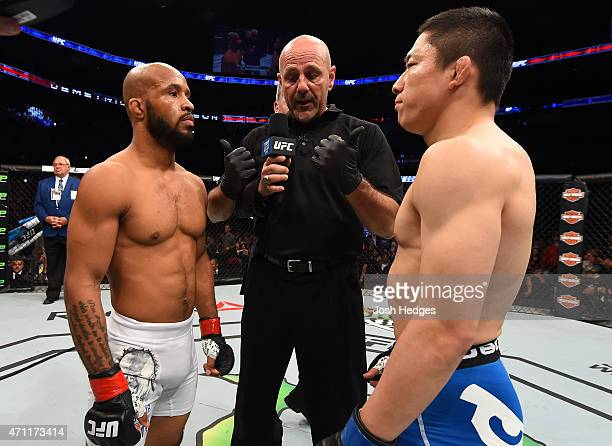 Opponents Demetrious Johnson of the United States and Kyoji Horiguchi of Japan face off before their UFC flyweight championship bout during the UFC...