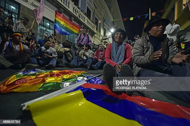 Opponents demonstrate against the government of Ecuadorean President Rafael Correa in front of riot policemen in Quito on September 16 2015 AFP PHOTO...