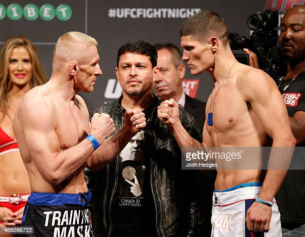 Opponents Dennis Siver of Germany and Charles Rosa face off during the UFC weighin at the Ericsson Globe Arena on October 3 2014 in Stockholm Sweden