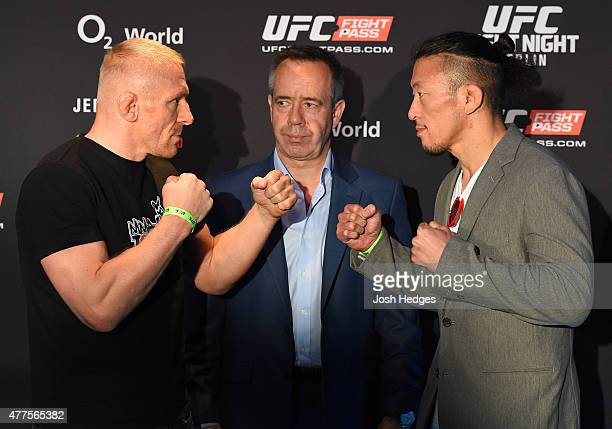 Opponents Dennis Siver of Germany and Tatsuya Kawajiri of Japan face off during the UFC Berlin Ultimate Media Day at the O2 World on June 18, 2015 in...