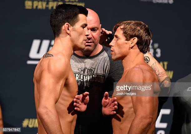 Opponents Dominick Cruz and Urijah Faber face off during the UFC 199 weighin at the Forum on June 3 2016 in Inglewood California