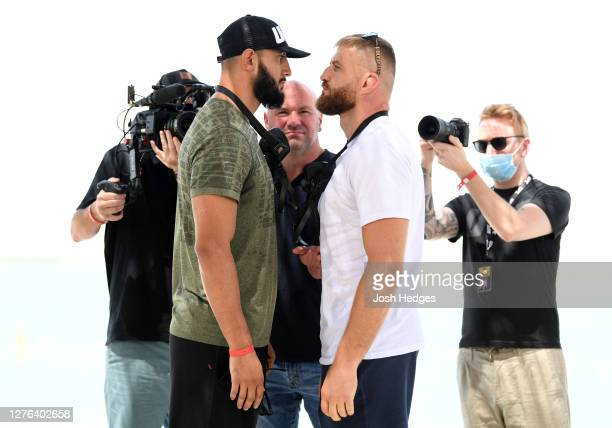 Opponents Dominick Reyes and Jan Blachowicz of Poland face off during the UFC 253 Press Conference on September 24 2020 at Yas Beach on UFC Fight...