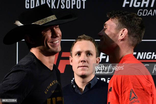 Opponents Donald Cerrone and Darren Till of England face off during the UFC Fight Night Media Day inside Ergo Arena on October 19 2017 in Gdansk...
