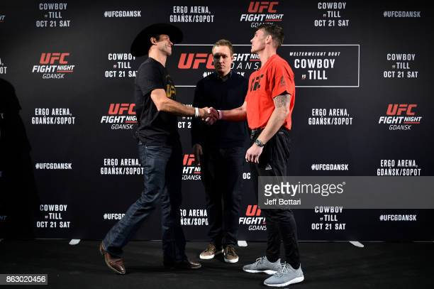 Opponents Donald Cerrone and Darren Till of England greet each other onstage during the UFC Fight Night Media Day inside Ergo Arena on October 19...