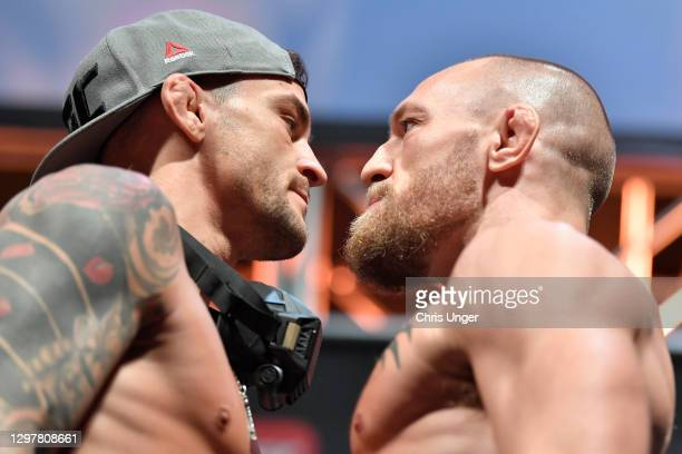 Opponents Dustin Poirier and Conor McGregor of Ireland face off during the UFC 257 weigh-in at Etihad Arena on UFC Fight Island on January 22, 2021...