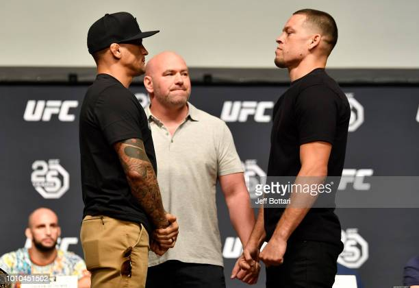 Opponents Dustin Poirier and Nate Diaz face off during the UFC press conference inside the Orpheum Theater on August 3 2018 in Los Angeles California