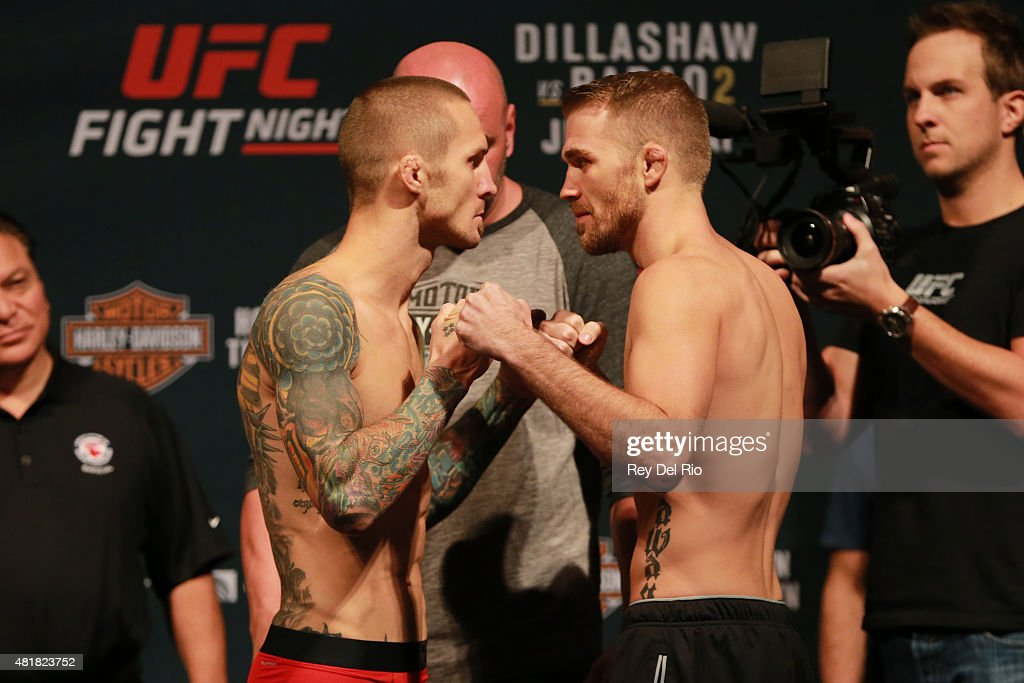 Opponents Eddie Wineland and Bryan Caraway face off during the UFC weigh-in at the United Center on July 24, 2015 in Chicago, Illinois.