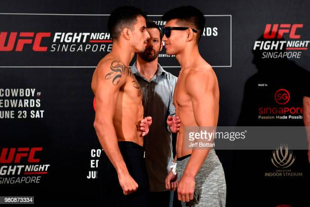 Opponents Felipe Arantes of Brazil and Song Yadong of China face off during the UFC Fight Night weighin at the Mandarin Oriental on June 22 2018 in...