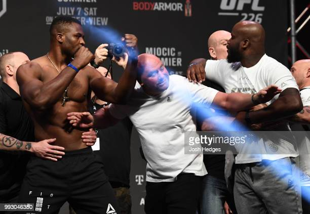 Opponents Francis Ngannou of Cameroon and Derrick Lewis face off during the UFC 226 weighin inside TMobile Arena on July 6 2018 in Las Vegas Nevada