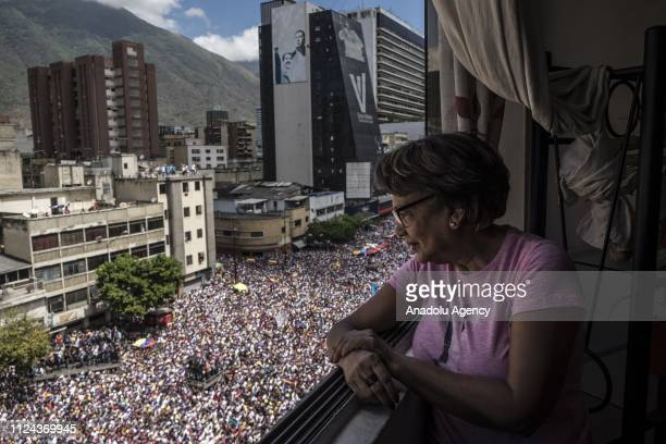 Opponents gather to stage a protest after the call from self-proclaimed interim president of Venezuela, Juan Guaido demanding soldiers to allow the...
