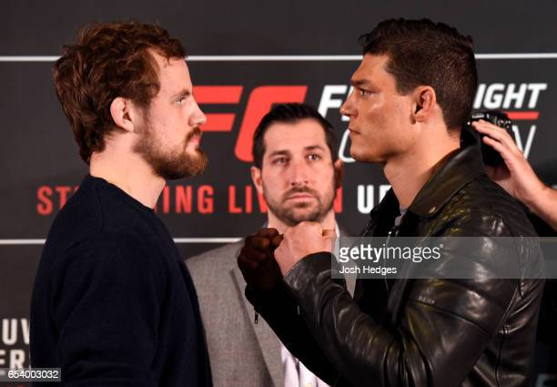 Opponents Gunnar Nelson of Iceland and Alan Jouban of the United States face off during the UFC Ultimate Media Day at Glaziers Hall on March 16 2017...