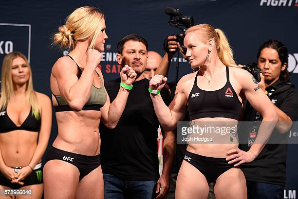 Opponents Holly Holm and Valentina Shevchenko of Kyrgyzstan face off during the UFC weighin at the United Center on July 22 2016 in Chicago Illinois