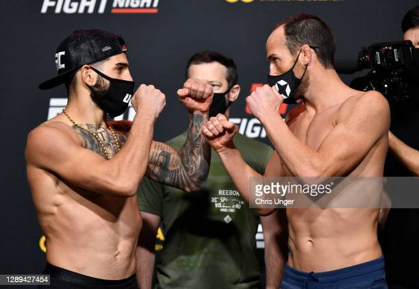 Opponents Ilia Topuria of Germany and Damon Jackson face off during the UFC Fight Night weigh-in at UFC APEX on December 04, 2020 in Las Vegas,...