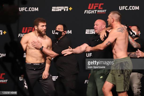 Opponents Ion Cutelaba of Moldova and Dustin Jacoby face off during the UFC Fight Night: Reyes v Prochazka Weigh-in at UFC Apex on April 30 in Las...