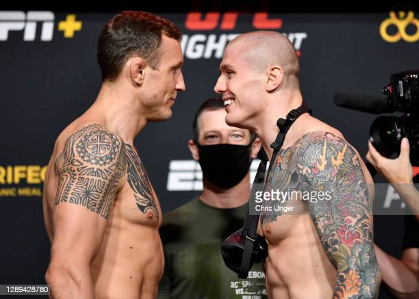 Opponents Jack Hermansson of Sweden and Marvin Vettori of Italy face off during the UFC Fight Night weigh-in at UFC APEX on December 04, 2020 in Las...