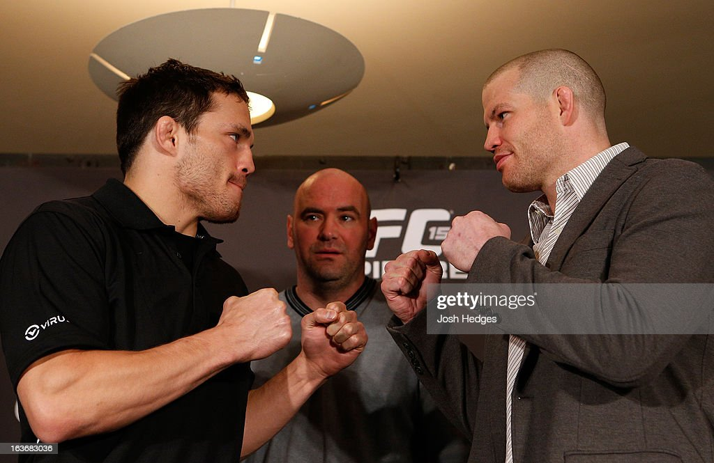Opponents Jake Ellenberger and Nate Marquardt face off during the final press conference ahead of his UFC 158 bout at Bell Centre on March 14, 2013 in Montreal, Quebec, Canada.