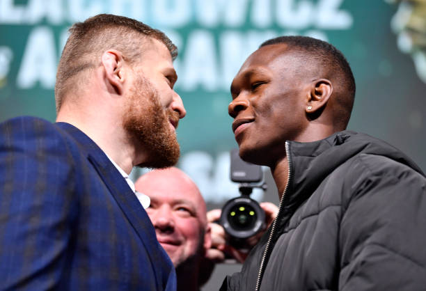 Opponents Jan Blachowicz of Poland and Israel Adesanya of Nigeria face off during the UFC 259 press conference at UFC APEX on March 04, 2021 in Las...