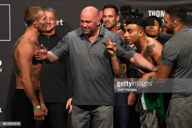 Opponents Jason Knight and Makwan Amirkhani of Kurdistan face off during the UFC Weighin at ECHO Arena on May 26 2018 in Liverpool England