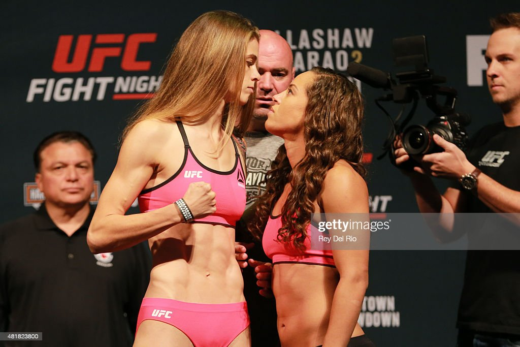 Opponents Jessamyn Duke and Elizabeth Phillips face off during the UFC weigh-in at the United Center on July 24, 2015 in Chicago, Illinois.
